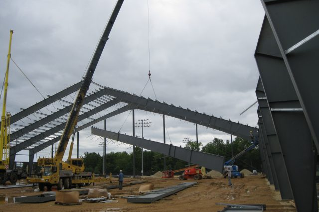 steel beams being erected for new commercial building project