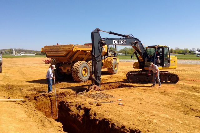 excavator digging land for the foundation of a new construction project