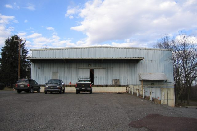before photo of rundown auto building that needs to be renovated