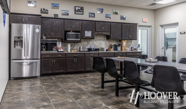 office breakroom with wood cabinets