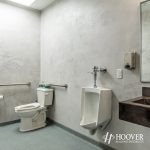 newly designed office bathroom with gray walls
