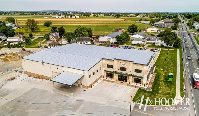 aerial view of metal roof on new office space and attached warehouse
